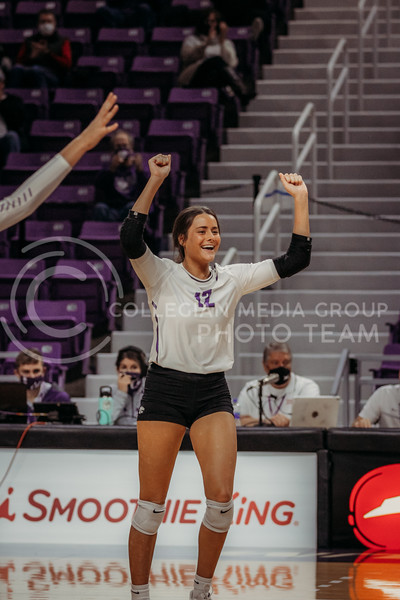 Sophomore defensive specialist Loren Hinkle celebrates a point during the game against Texas Christian University on Nov. 13, 2020. (Sophie Osborn | Collegian Media Group)