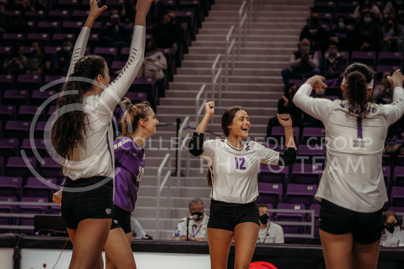 The team celebrates after a long point during the game against Texas Christian University on Nov. 13, 2020. (Sophie Osborn | Collegian Media Group)