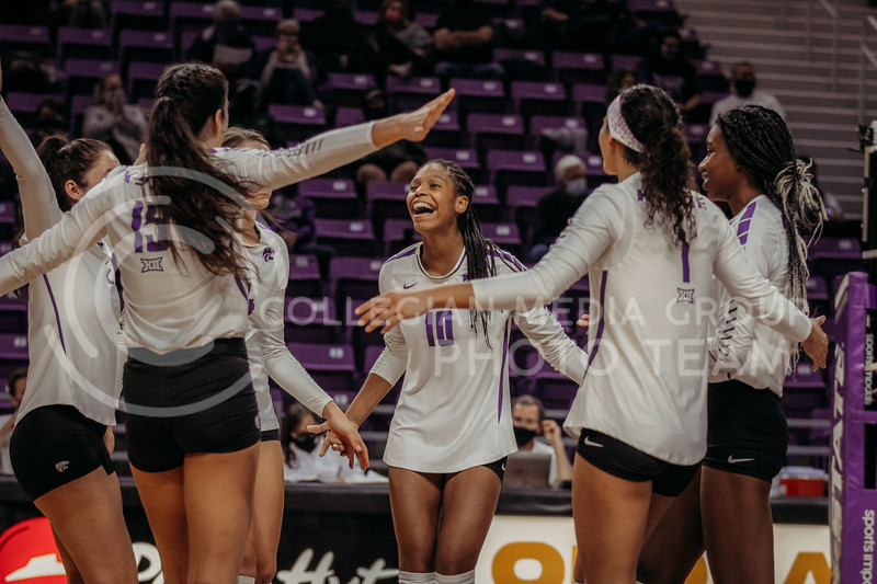 The team celebrates a teammates successful hit during the game against Texas Christian University on Nov. 13, 2020. (Sophie Osborn | Collegian Media Group)