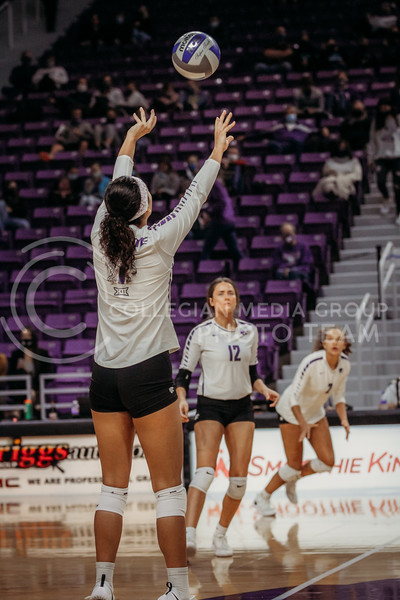 Sophomore setter Teana Adams-Kaonohi sets the ball to a teammate during the game against Texas Christian University on Nov. 13, 2020. (Sophie Osborn | Collegian Media Group)