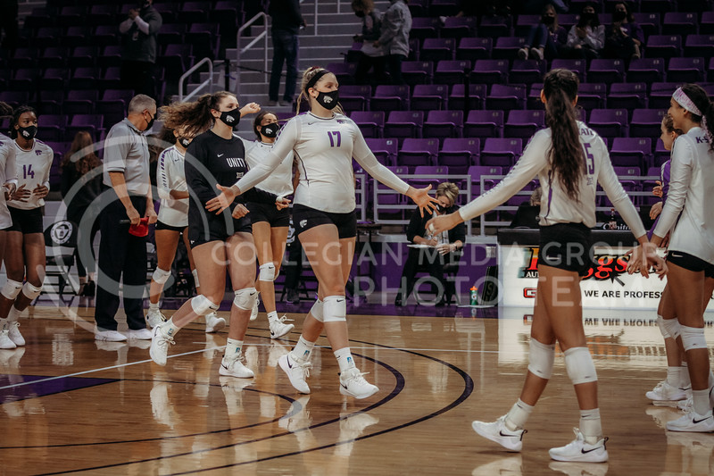 Junior Brynn Carlson runs to the court to celebrate with teammates after a win against Texas Christian University on Nov. 13, 2020. (Sophie Osborn | Collegian Media Group)