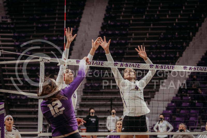 Kansas State players look to block a ball during the game against Texas Christian University on Nov. 13, 2020. (Sophie Osborn | Collegian Media Group)
