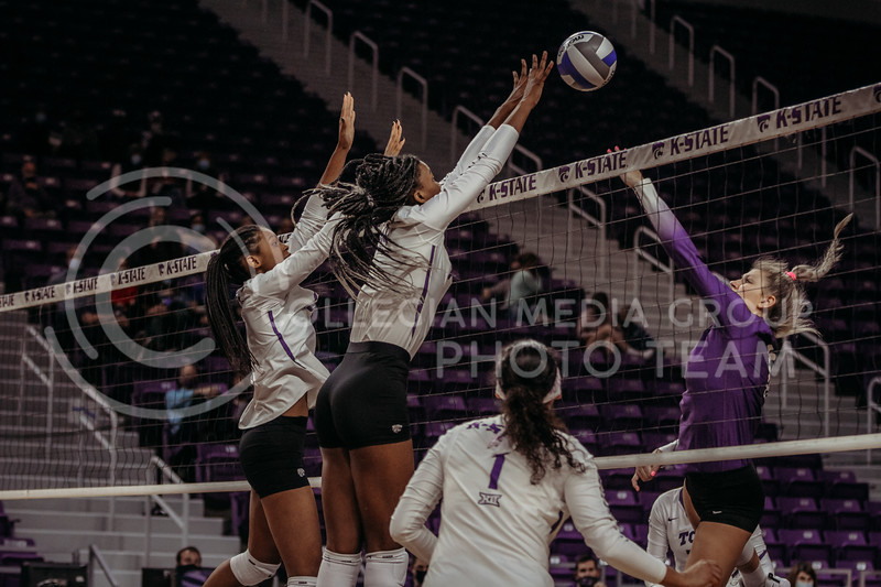 Freshman Jayden Nembhard and Junior Megan Vernon work together to successfully block the ball during the game against Texas Christian University on Nov. 13, 2020. (Sophie Osborn | Collegian Media Group)