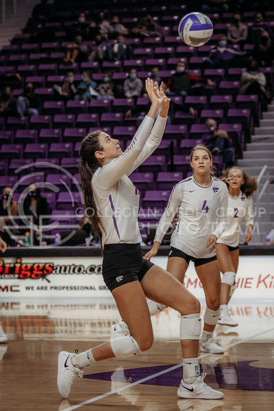 Sophomore Holly Bonde looks to the set the ball to a teammate during the game against Texas Christian University on Nov. 13, 2020. (Sophie Osborn | Collegian Media Group)