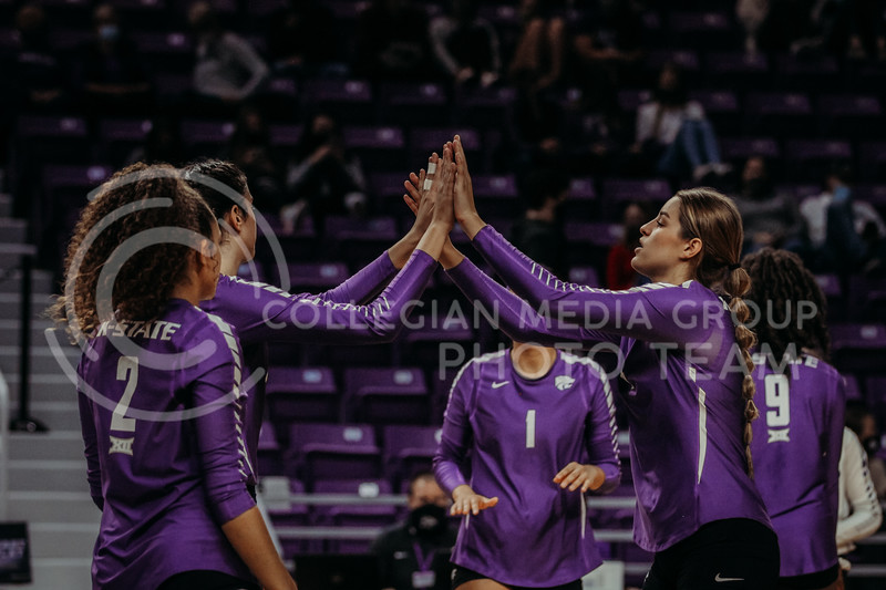 Teammates celebrate in between sets during the Nov. 14, 2020 game against Texas Christian University. (Sophie Osborn | Collegian Media Group)