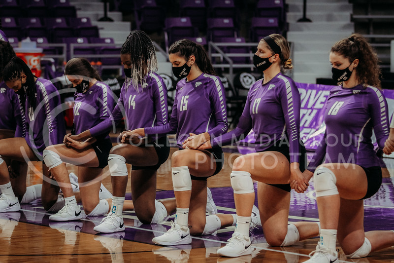 Part of the Kansas State volleyball team kneels during the national anthem before the Nov. 14, 2020 game against Texas Christian University. (Sophie Osborn | Collegian Media Group)