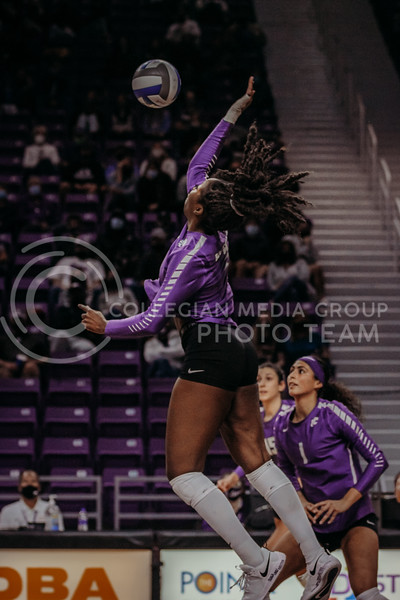 Sophomore Abigail Archibong looks to hit the ball back across the net during the Nov. 14, 2020 game against Texas Christian University. (Sophie Osborn | Collegian Media Group)