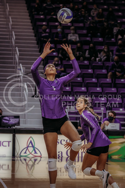 Sophomore setter Teana Adams-Kaonhi looks to set the ball to teammate Freshman middle blocker Kadye Fernholz during the Nov. 14, 2020 game against Texas Christian University. (Sophie Osborn | Collegian Media Group)