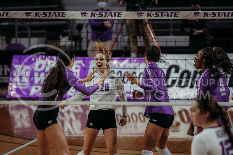 Freshman libero Mackenzie Morris celebrates with teammates after winning an exciting point during the Nov. 14, 2020 game against Texas Christian University. (Sophie Osborn | Collegian Media Group)