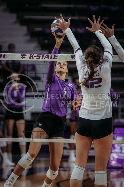 Freshman middle blocker Kadye Fernholz looks to tip the ball back during the Nov. 14, 2020 game against Texas Christian University. (Sophie Osborn | Collegian Media Group)