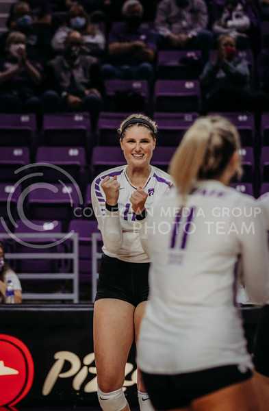 Brynn Carlson looks to teammates after winning an exciting point during the Kansas State volleyball game against Texas at Bramlage Coliseum on Oct. 17, 2020. (Sophie Osborn | Collegian Media Group)
