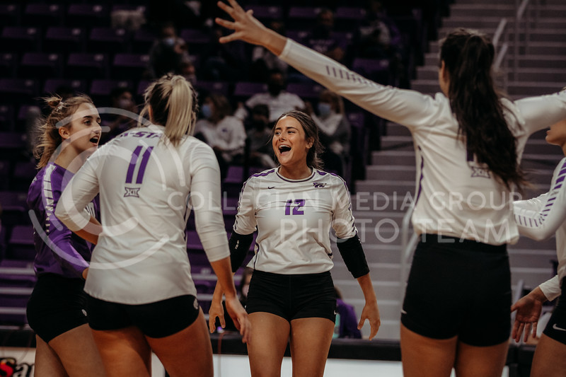 Teammates rally together in between points during the Kansas State volleyball game against Texas at Bramlage Coliseum on Oct. 17, 2020. (Sophie Osborn | Collegian Media Group)