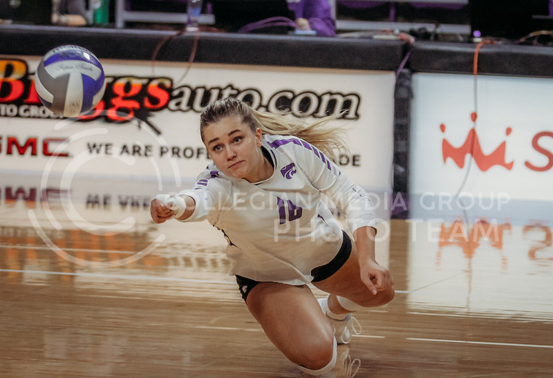 Dru Kuck dives to save the ball during the Kansas State volleyball game against Texas at Bramlage Coliseum on Oct. 17, 2020. (Sophie Osborn | Collegian Media Group)