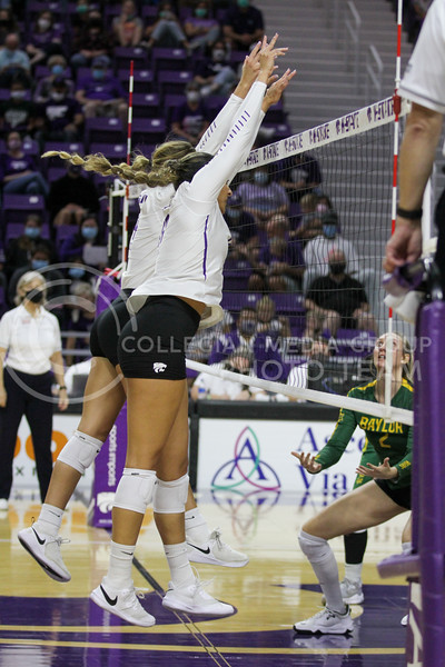 Teammates jump to block an oncoming ball during the game against Baylor on September 25, 2021 at Bramlage Coliseum. (Sophie Osborn   Collegian Media Group)