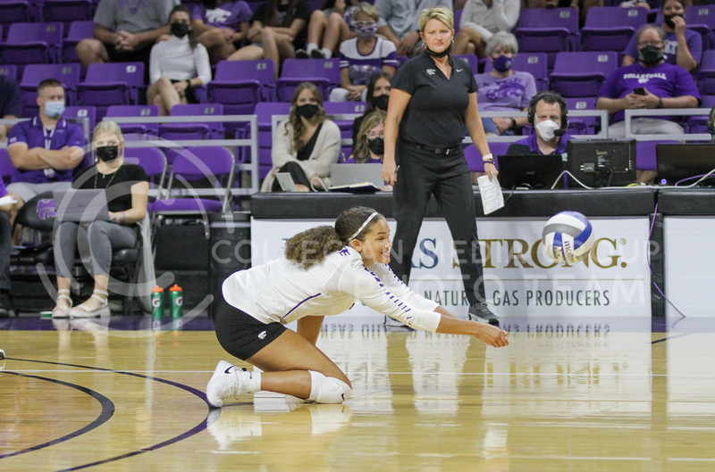 Sophomore Aliyah Carter dives for the ball during the game against Baylor on September 25, 2021 at Bramlage Coliseum. (Sophie Osborn   Collegian Media Group)
