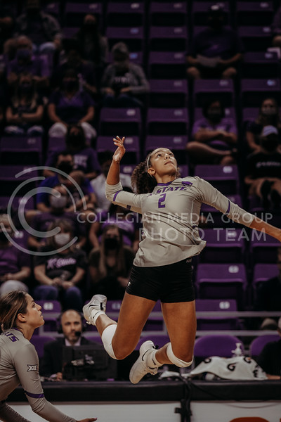 Sophomore Aliyah Carter jumps to hit the ball during the September 9, 2021 game against Ohio at Bramlage Coliseum. (Sophie Osborn   Collegian Media Group)
