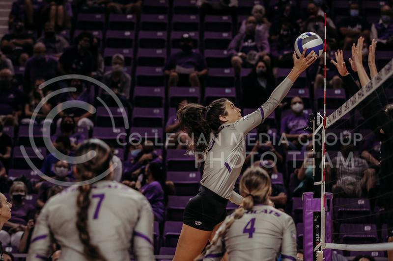 Junior Holly Bonde taps the ball over the net during the September 9, 2021 game against Ohio at Bramlage Coliseum. (Sophie Osborn   Collegian Media Group)