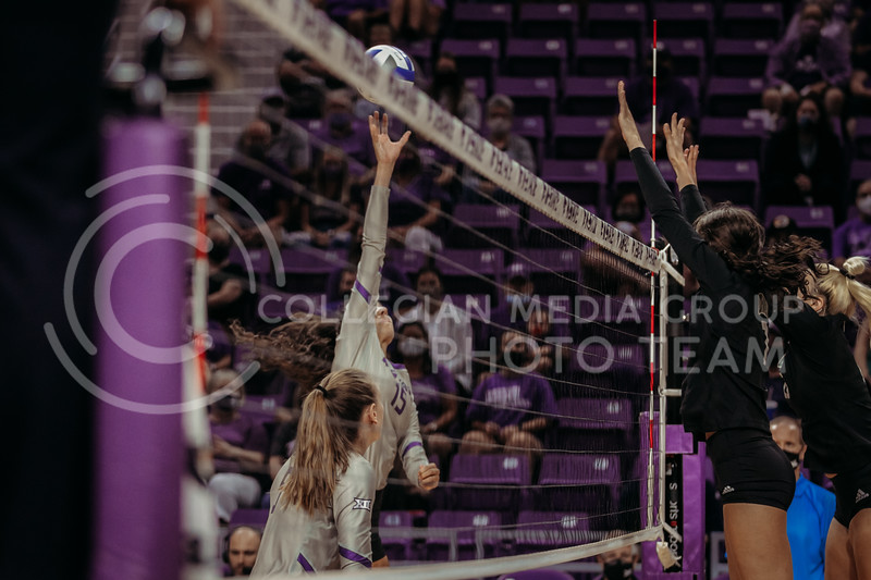 Junior Holly Bonde attempts to tip the ball over the net during the September 9, 2021 game against Ohio at Bramlage Coliseum. (Sophie Osborn   Collegian Media Group)