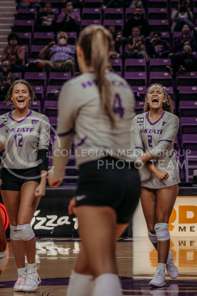 Kadye Fernholz and Aliyah Carter celebrate a teammates success during the game against Oklahoma on Oct. 22, 2020. (Sophie Osborn | Collegian Media Group)