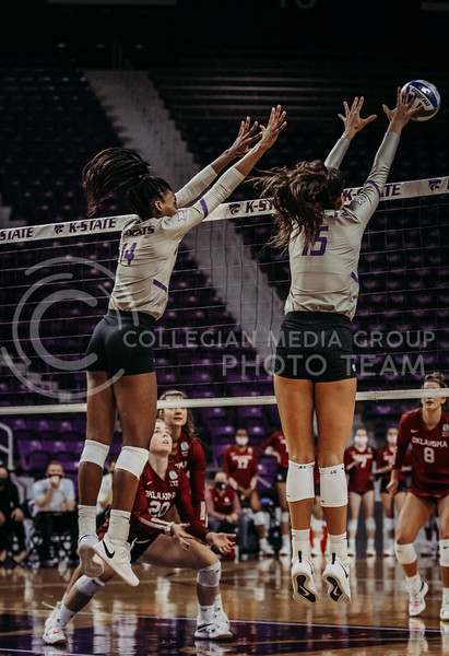Megan Vernon and Holly Bonde block an oncoming ball during the game against Oklahoma on Oct. 22, 2020. (Sophie Osborn | Collegian Media Group)