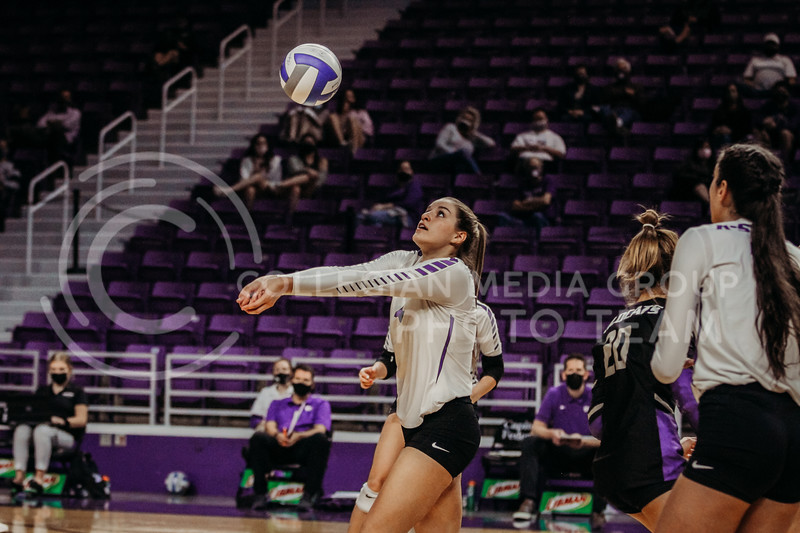 Freshman middle blocker Kadye Fernholz eyes the ball in preparation to pass during the game against Texas State on March 4, 2021 game at Bramlage Coliseum. (Sophie Osborn   Collegian Media Group)