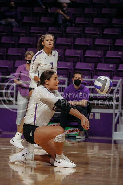 Sophomore Loren Hinkle readies to pass the ball to a teammate during the game against Texas State on March 4, 2021 game at Bramlage Coliseum. (Sophie Osborn   Collegian Media Group)