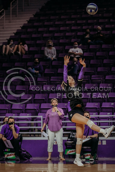 Freshman libero Mackenzie Morris leaps to set the ball during the game against Texas State on March 4, 2021 game at Bramlage Coliseum. (Sophie Osborn   Collegian Media Group)