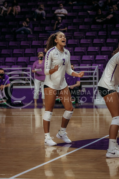Freshman outside hitter Aliyah Carter celebrates a teammates success during the game against Texas State on March 4, 2021 game at Bramlage Coliseum. (Sophie Osborn   Collegian Media Group)