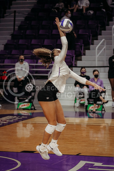 Freshman outside hitter Aliyah Carter hits the ball during the game against Texas State on March 4, 2021 game at Bramlage Coliseum. (Sophie Osborn   Collegian Media Group)