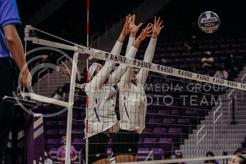Sophomore Teana Adams-Kaonohi and Freshman Kadye Fernholz ready to block an oncoming ball during the game against Texas State on March 4, 2021 game at Bramlage Coliseum. (Sophie Osborn   Collegian Media Group)