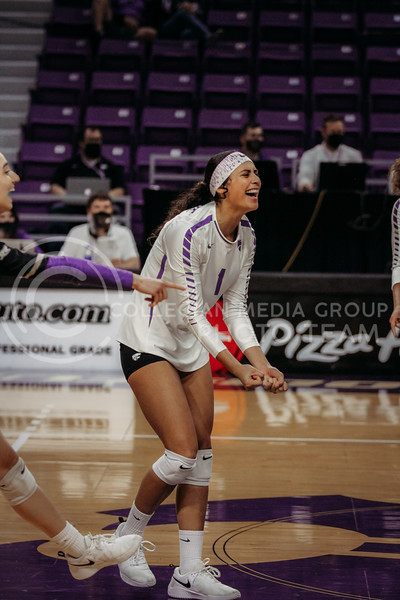 Sophomore setter Teana Adams-Kaonohi celebrates with teammates during the game against Texas State on March 4, 2021 game at Bramlage Coliseum. (Sophie Osborn   Collegian Media Group)