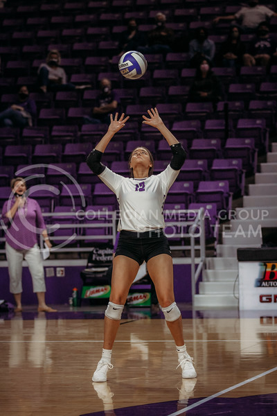 Sophomore Loren Hinkle prepares to set the ball during the game against Texas State on March 4, 2021 game at Bramlage Coliseum. (Sophie Osborn   Collegian Media Group)