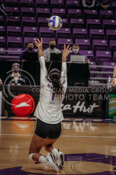 Sophomore setter Teana Adams-Kaonohi sets the ball up during the game against Texas State on March 4, 2021 game at Bramlage Coliseum. (Sophie Osborn   Collegian Media Group)