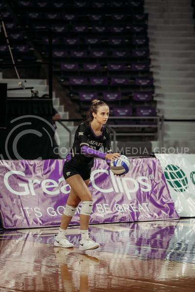 Sophomore Mackenzie Morris prepares to serve during the August 22nd game against University of Missouri-Kansas City at Bramlage Coliseum. (Sophie Osborn | The Collegian Media Group)