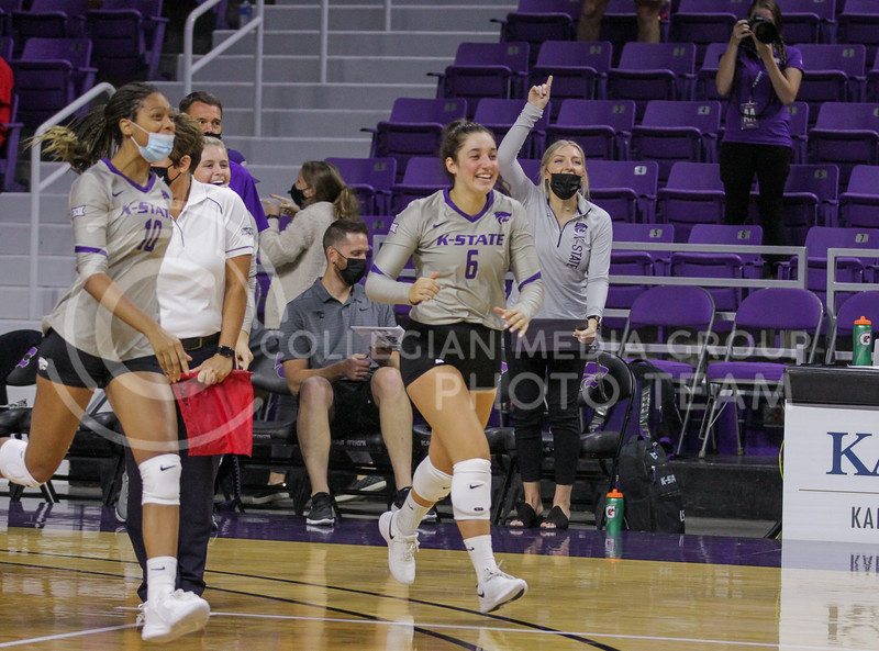 Players from the sideline run to greet teammates during the August 22nd game against University of Missouri-Kansas City at Bramlage Coliseum. (Sophie Osborn | The Collegian Media Group)