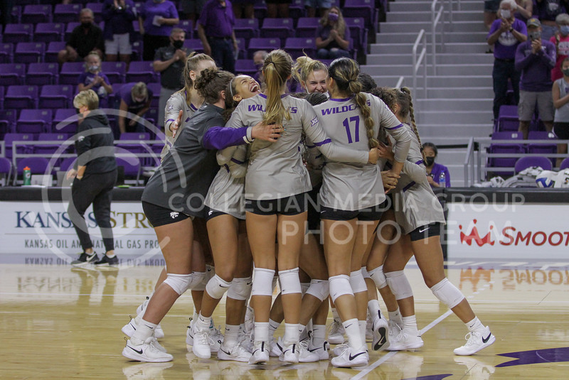 The team celebrates a win after a close game during the August 22nd game against University of Missouri-Kansas City at Bramlage Coliseum. (Sophie Osborn | The Collegian Media Group)