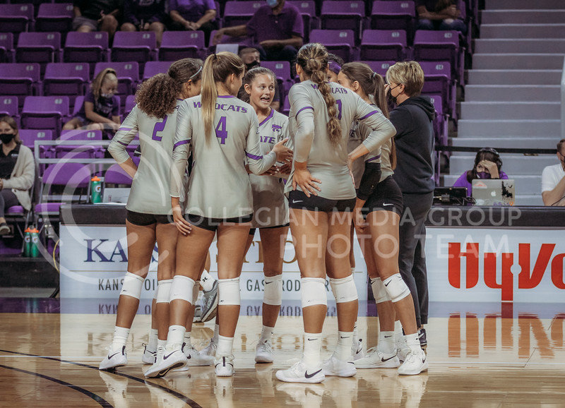 The team talks before going back out onto the floor during the August 22nd game against University of Missouri-Kansas City at Bramlage Coliseum. (Sophie Osborn | The Collegian Media Group)