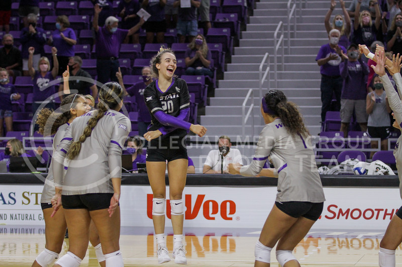 Sophomore Mackenzie Morris celebrates a game winning serve during the August 22nd game against University of Missouri-Kansas City at Bramlage Coliseum. (Sophie Osborn | The Collegian Media Group)