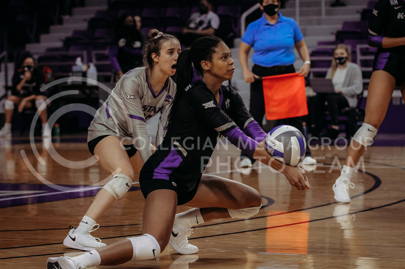 Sophomore Abigail Archibong dives for the ball during the March 28, 2021 spring volleyball game against Wayne State at Bramlage Coliseum. (Sophie Osborn | Collegian Media Group)