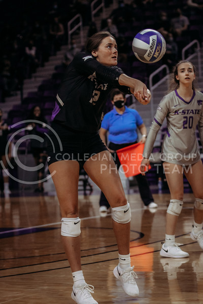 Sophomore Loren Hinkle concentrates on the ball during the March 28, 2021 spring volleyball game against Wayne State at Bramlage Coliseum. (Sophie Osborn | Collegian Media Group)