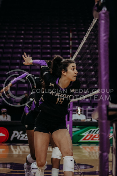 Sophomore Holly Bonde prepares to block during the March 28, 2021 spring volleyball game against Wayne State at Bramlage Coliseum. (Sophie Osborn | Collegian Media Group)