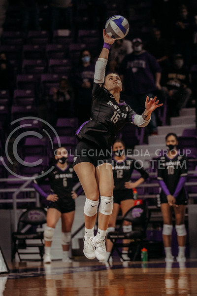 Sophomore Dru Kuck serves the ball during the March 28, 2021 spring volleyball game against Wayne State at Bramlage Coliseum. (Sophie Osborn | Collegian Media Group)