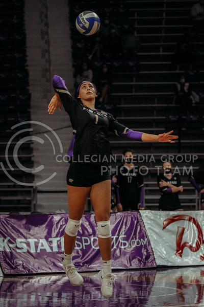 Sophomore Teana Adams-Kaonohi serves the ball during the March 28, 2021 spring volleyball game against Wayne State at Bramlage Coliseum. (Sophie Osborn | Collegian Media Group)