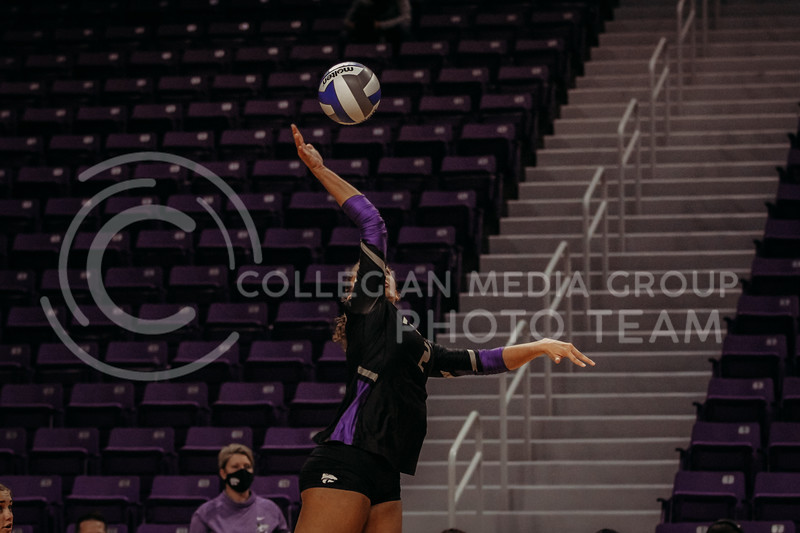 Freshman Aliyah Carter hits the ball during the March 28, 2021 spring volleyball game against Wayne State at Bramlage Coliseum. (Sophie Osborn | Collegian Media Group)