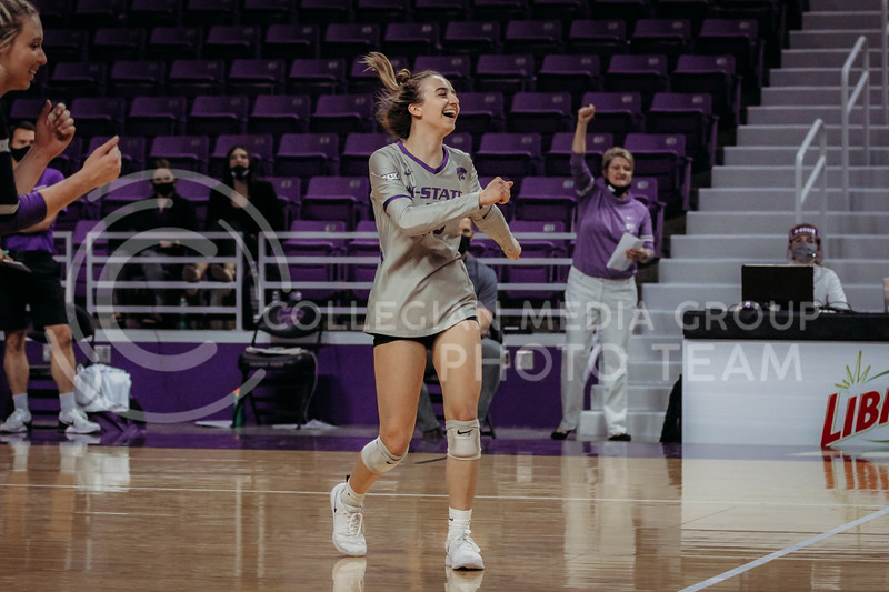 Freshman libero Mackenzie Morris celebrates during the March 28, 2021 spring volleyball game against Wayne State at Bramlage Coliseum. (Sophie Osborn | Collegian Media Group)