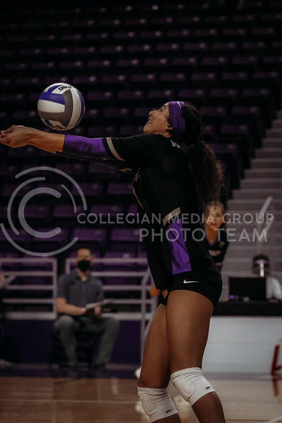 Sophomore Teana Adams-Kaonohi hits the ball up during the March 28, 2021 spring volleyball game against Wayne State at Bramlage Coliseum. (Sophie Osborn | Collegian Media Group)