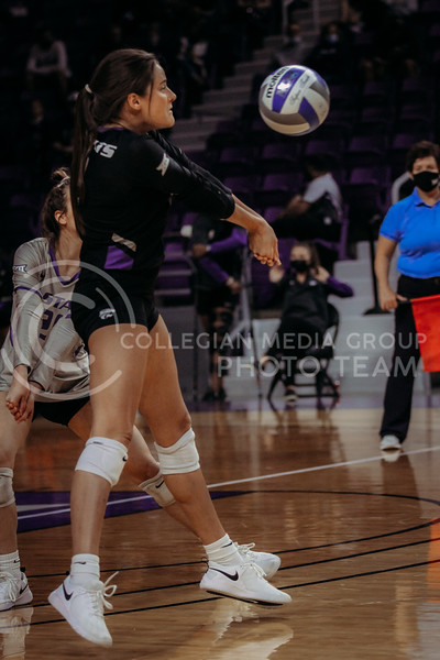 Sophomore Loren Hinkle passes the ball during the March 28, 2021 spring volleyball game against Wayne State at Bramlage Coliseum. (Sophie Osborn | Collegian Media Group)
