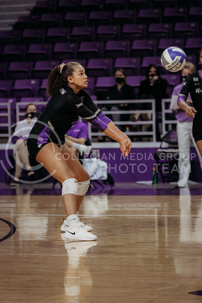Freshman Aliyah Carter looks to pass the ball during the March 28, 2021 spring volleyball game against Wayne State at Bramlage Coliseum. (Sophie Osborn | Collegian Media Group)
