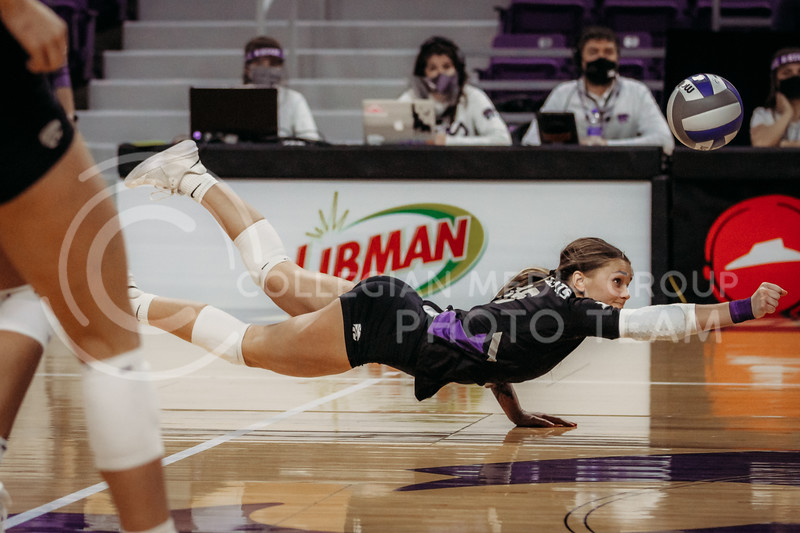 Sophomore Dru Kuck dives to save the ball during the March 28, 2021 spring volleyball game against Wayne State at Bramlage Coliseum. (Sophie Osborn | Collegian Media Group)