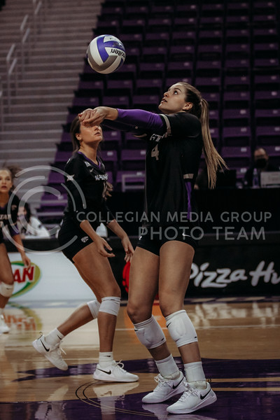 Freshman Kadye Fernholz hits the ball up during the March 28, 2021 spring volleyball game against Wayne State at Bramlage Coliseum. (Sophie Osborn | Collegian Media Group)
